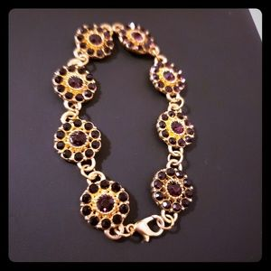 Fashion Bracelet with purple gems.